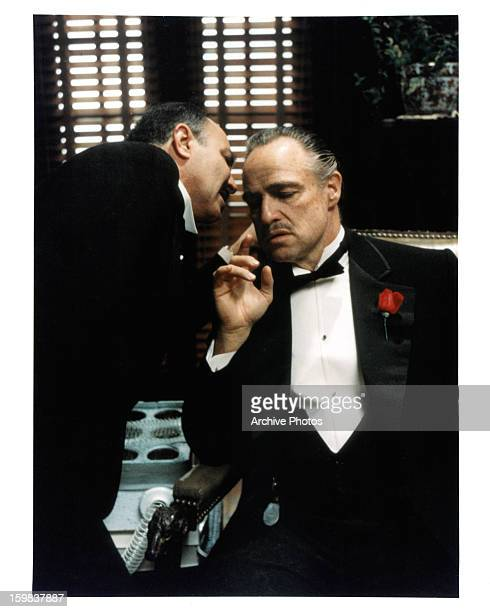 Marlon Brando receives a message in a scene from the film 'The Godfather' 1972