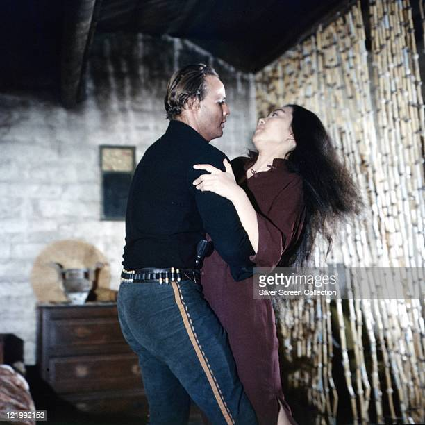 Marlon Brando US actor in costume embracing Katy Jurado Mexican actress in a publicity still issued for the film 'OneEyed Jacks' 1961 The western was...