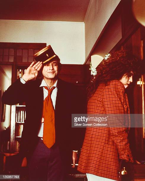 Marlon Brando US actor wearing a Gendarme's hat as he salutes Maria Schneider French actress who is wearing a red coat in a publicity still issued...