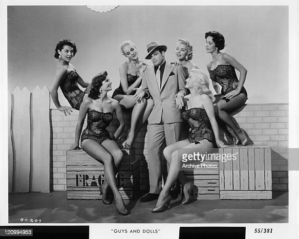 Marlon Brando with unidentified women in a scene from the film 'Guys And Dolls' 1955
