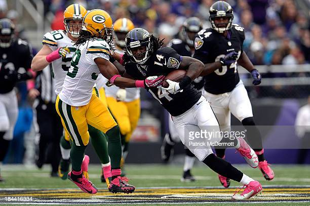 Marlon Brown of the Baltimore Ravens avoids the tackle of Tramon Williams of the Green Bay Packers as he runs down field in the third quarter during...