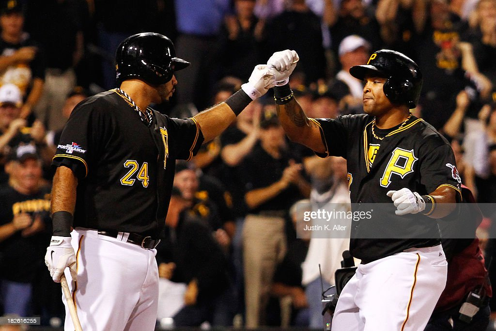 Marlon Byrd #2 celebrates his second inning home run with Pedro Alvarez #24 of the Pittsburgh Pirates during their National League Wild Card game against the Cincinnati Reds at PNC Park on October 1, 2013 in Pittsburgh, Pennsylvania.