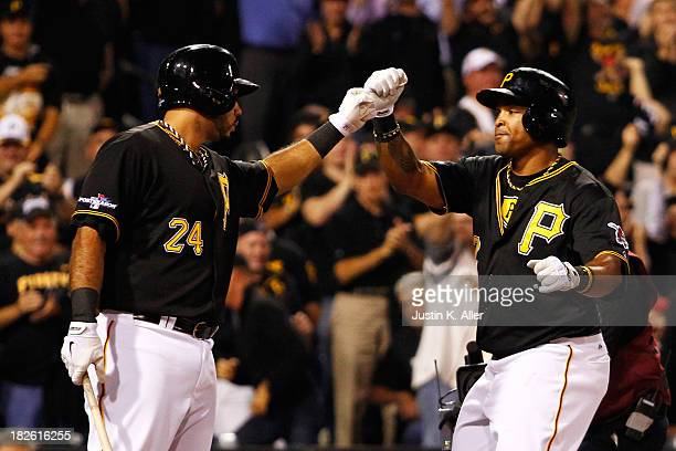 Marlon Byrd celebrates his second inning home run with Pedro Alvarez of the Pittsburgh Pirates during their National League Wild Card game against...