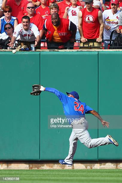 Marlon Byrd of the Chicago Cubs catches a deep fly ball against the St Louis Cardinals at Busch Stadium on April 14 2012 in St Louis Missouri