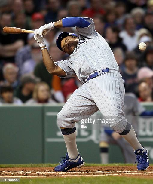Marlon Byrd of the Chicago Cubs is hits a in the head by a pitch in the second inning against the Boston Red Sox on May 21 2011 at Fenway Park in...