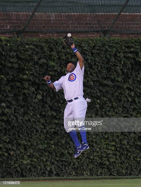 Marlon Byrd of the Chicago Cubs leaps to make a catch at the wall of a fly ball hit by Dan Uggla of the Atlanta Braves at Wrigley Field on August 23...