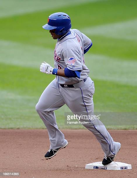 Marlon Byrd of the New York Mets rounds second base after hitting a solo home run against the Minnesota Twins during the fifth inning of the game on...