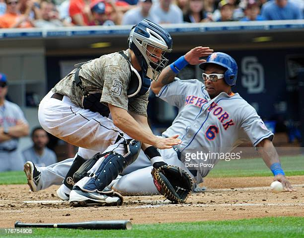 Marlon Byrd of the New York Mets scores ahead of the tag of Nick Hundley of the San Diego Padres during the fourth inning of a baseball game at Petco...
