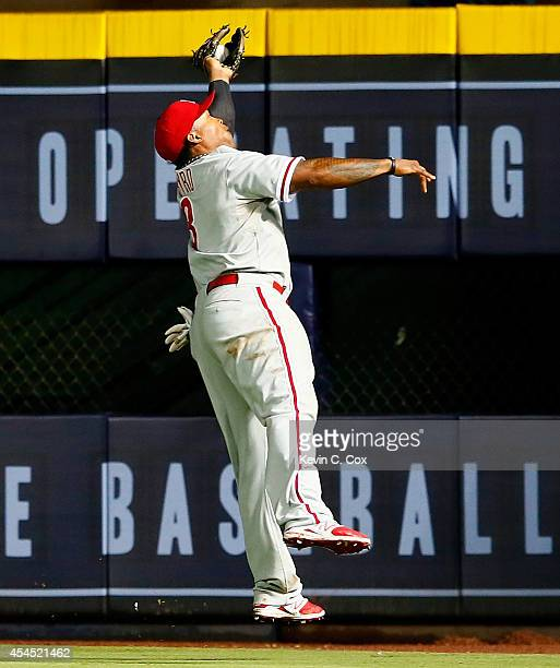 Marlon Byrd of the Philadelphia Phillies catches a deep ball hit by Tommy La Stella of the Atlanta Braves in the seventh inning at Turner Field on...