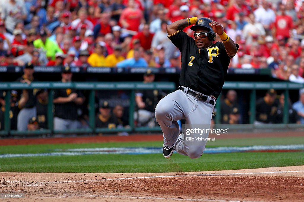 Marlon Byrd #2 of the Pittsburgh Pirates slides home to score a run in the seventh inning against the St. Louis Cardinals during Game Two of the National League Division Series at Busch Stadium on October 4, 2013 in St Louis, Missouri.