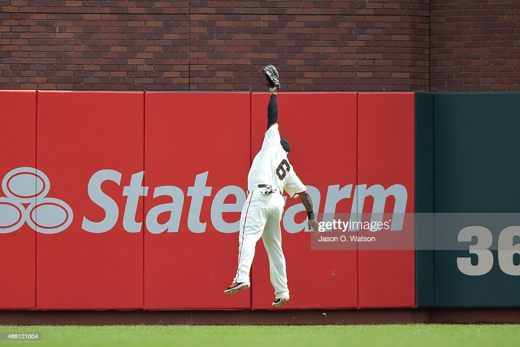 Marlon Byrd #6 of the San Francisco Giants catches a fly ball hit off the bat of Derek Norris (not pictured) of the San Diego Padres during the fourth inning at AT&T Park on September 13, 2015 in San Francisco, California. The San Francisco Giants defeated the San Diego Padres 10-3.