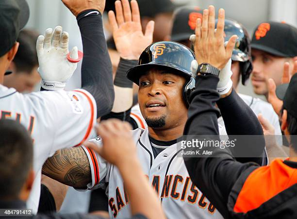 Marlon Byrd of the San Francisco Giants celebrates after hitting a two run home run in the first inning during the game against the Pittsburgh...