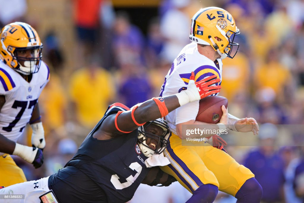 Marlon Davidson #3 of the Auburn Tigers hits Danny Etling #16 of the LSU Tigers at Tiger Stadium on October 14, 2017 in Baton Rouge, Louisiana. The LSU defeated the Auburn 27-23.