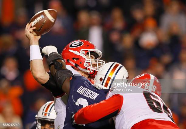 Marlon Davidson of the Auburn Tigers pressures Jake Fromm of the Georgia Bulldogs at Jordan Hare Stadium on November 11 2017 in Auburn Alabama