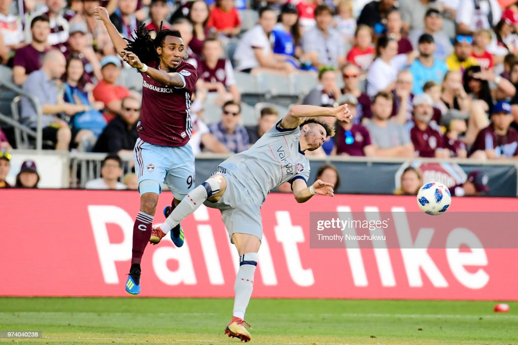 Marlon Hairston #94 of Colorado Rapids collides with Luis Solignac #9 of Chicago Fire at Dick's Sporting Goods Park on June 13, 2018 in Commerce City, Colorado.