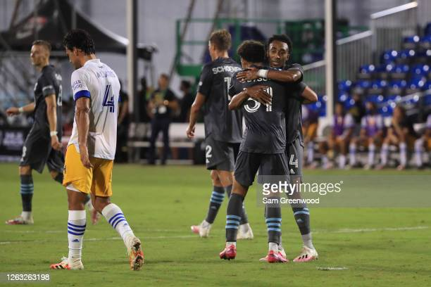 Marlon Hairston of Minnesota United celebrates with Hassani Dotson after scoring the fourth goal of his team during a quarter final match of MLS Is...