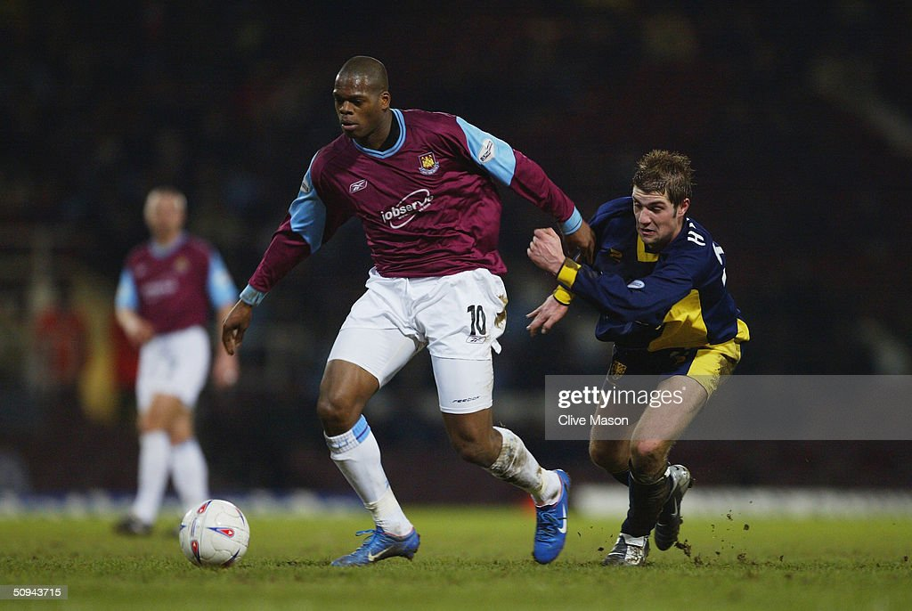 Marlon Harewood of West Ham United and Ben Harding of Wimbledon during the Nationwide Division One match between West Ham United and Wimbledon at Upton Park on March 9, 2004 in London.