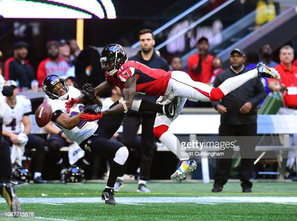 Marlon Humphrey of the Baltimore Ravens breaks up a pass against Julio Jones of the Atlanta Falcons at MercedesBenz Stadium on December 2 2018 in...