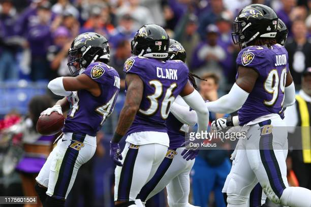 Marlon Humphrey of the Baltimore Ravens celebrates an interception against the Cincinnati Bengals during the first half at M&T Bank Stadium on...