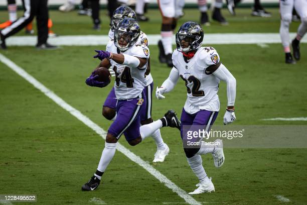 Marlon Humphrey of the Baltimore Ravens celebrates with teammates after a turnover against the Cleveland Browns during the first half at M&T Bank...