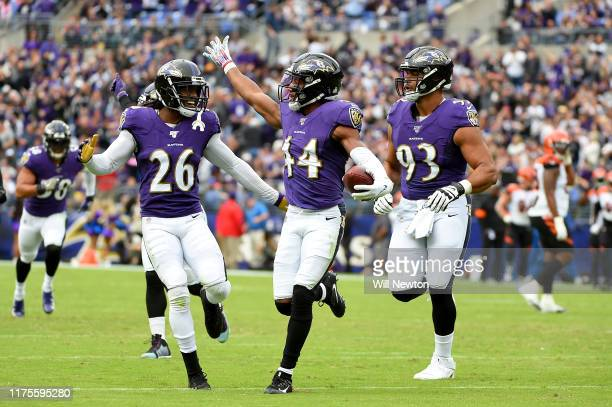 Marlon Humphrey of the Baltimore Ravens celebrates with teammates after making an interception against the Cincinnati Bengals during the first half...