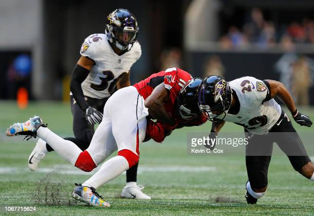 Marlon Humphrey of the Baltimore Ravens is flagged for targeting as he tackles Julio Jones of the Atlanta Falcons at Mercedes-Benz Stadium on...