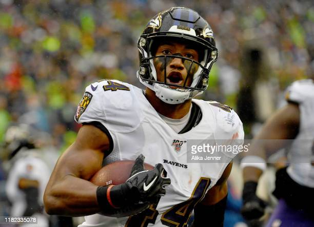 Marlon Humphrey of the Baltimore Ravens scoops and scores on a 18 yard fumble by DK Metcalf of the Seattle Seahawks in the fourth quarter the game at...