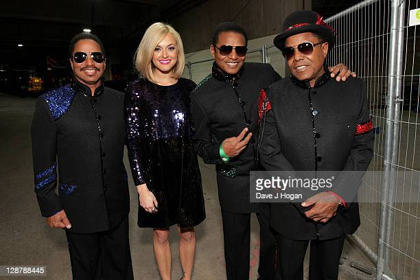 Marlon Jackson, Fearne Cotton, Jackie Jackson and Tito Jackson pose for a portrait backstage at the 'Michael Forever' concert to remember the late...
