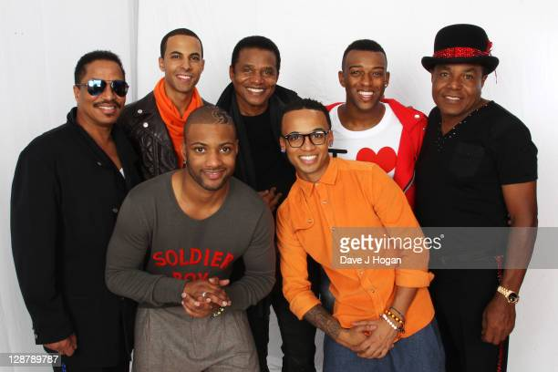 Marlon Jackson, Marvin Humes, JB Gill, Jackie Jackson, Aston Merrygold, OritsT Williams and Tito Jackson pose for a portrait backstage at the...