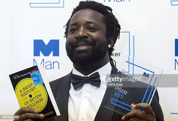 Marlon James author of 'A Brief History of Seven Killings' poses for photographers after winning the Man Booker Prize for Fiction 2015 at The...
