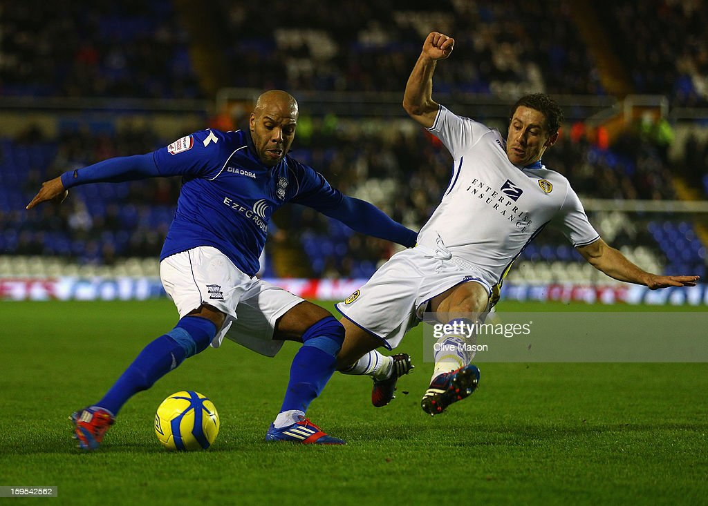 Marlon King of Birmingham City is tackled by Michael Brown of Leeds United during the FA Cup with Budweiser Third Round Replay match between Birmingham City and Leeds United at St Andrews on January 15, 2013 in Birmingham, England.