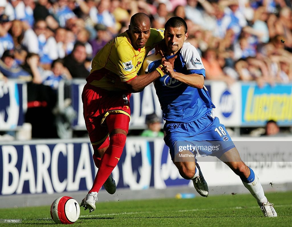 Marlon King of Watford and Paul Scharner of Wigan challenge for the ball during the Barclays Premiership match between Wigan Athletic and Watford at the JJB Stadium on September 23, 2006 in Wigan, England.