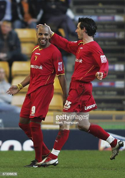 Marlon King of Watford celebrates his goal with team mate Matthew Spring during The Coca Cola Championship match between Wolverhampton Wanderers and...