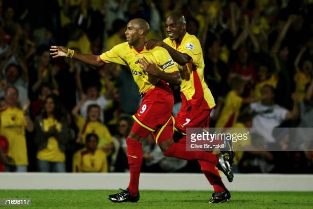 Marlon King of Watford celebrates scoring the first goal of the game with team mate Damien Francis during the Barclays Premiership match between...
