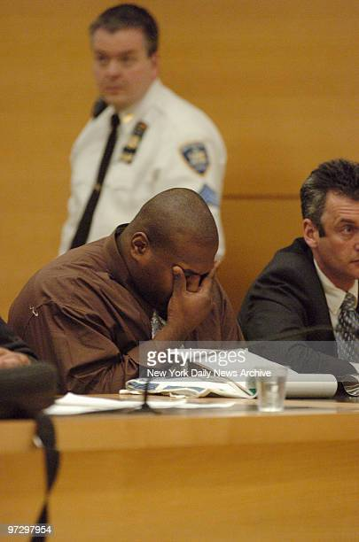 Marlon Legere who was found guilty on Feb 2 of the Sept 2004 shooting deaths of NYPD detectives Robert Parker and Patrick Rafferty rubs his eyes as...