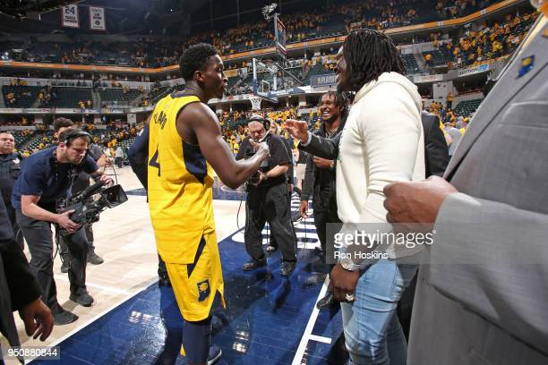 Marlon Mack exchanges a handshake with Victor Oladipo of the Indiana Pacers during Game Three of Round One of the 2018 NBA Playoffs between the...