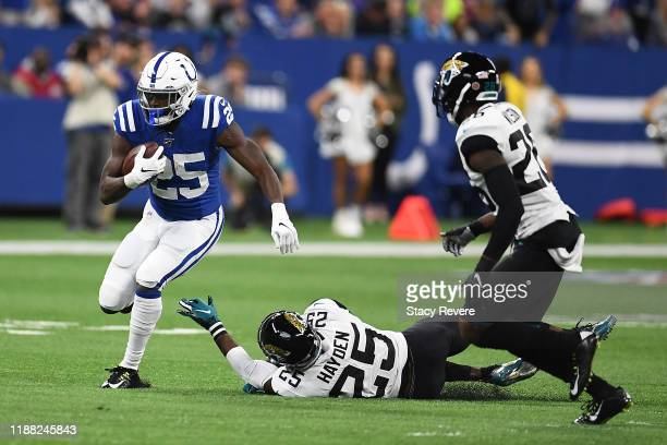 Marlon Mack of the Indianapolis Colts breaks a tackle by D.J. Hayden of the Jacksonville Jaguars during the first quarter at Lucas Oil Stadium on...