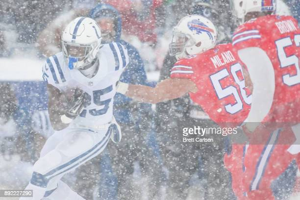 Marlon Mack of the Indianapolis Colts carries the ball during the second quarter against the Buffalo Bills at New Era Field on December 10 2017 in...