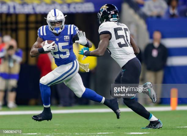 Marlon Mack of the Indianapolis Colts runs the ball as Telvin Smith of the Jacksonville Jaguars tries to make the stop at Lucas Oil Stadium on...