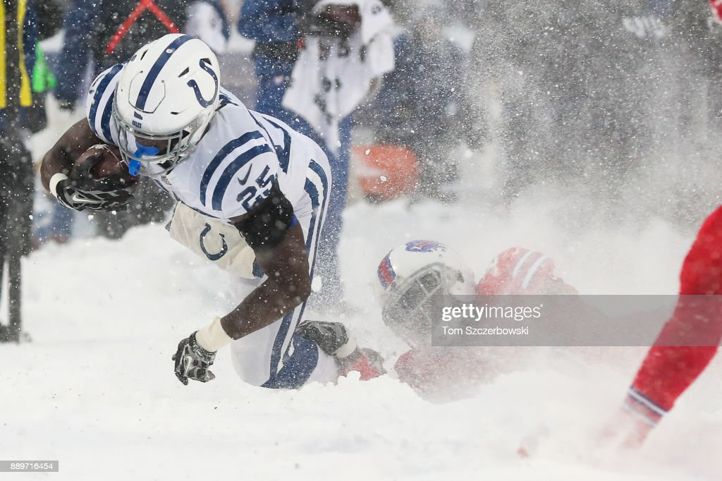 Marlon Mack #25 of the Indianapolis Colts runs the ball as Tre'Davious White #27 of the Buffalo Bills attempts to tackle him during the fourth quarter December 10, 2017 at New Era Field in Orchard Park, New York.