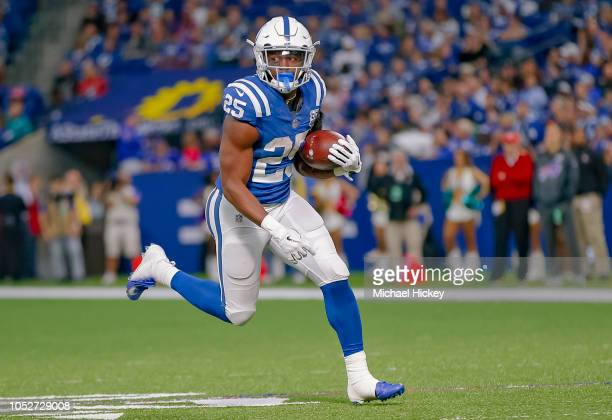 Marlon Mack of the Indianapolis Colts runs the ball during the game against the Buffalo Bills at Lucas Oil Stadium on October 21 2018 in Indianapolis...