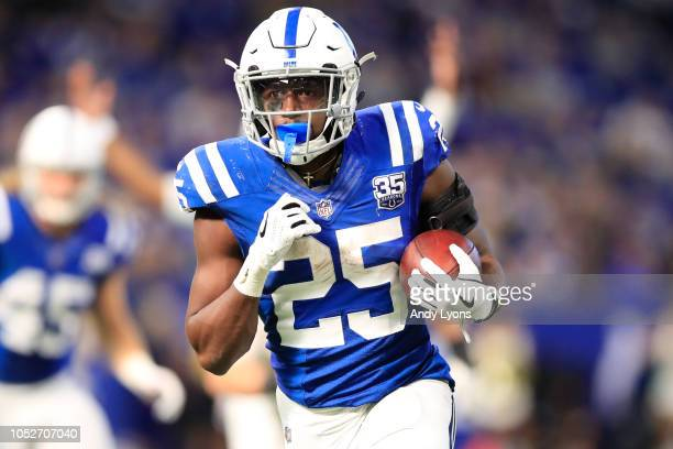 Marlon Mack of the Indianapolis Colts runs the ball in the fourth quarter against the Buffalo Billsat Lucas Oil Stadium on October 21 2018 in...