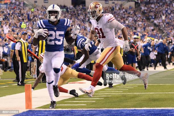 Marlon Mack of the Indianapolis Colts rushes for a touchdown against the San Francisco 49ers during the second half of a game at Lucas Oil Stadium on...