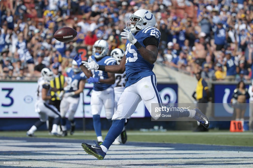 Marlon Mack #25 of the Indianapolis Colts scores a touchdown in the fourth quarter during the game against the Los Angeles Rams at the Los Angeles Memorial Coliseum on September 10, 2017 in Los Angeles, California.