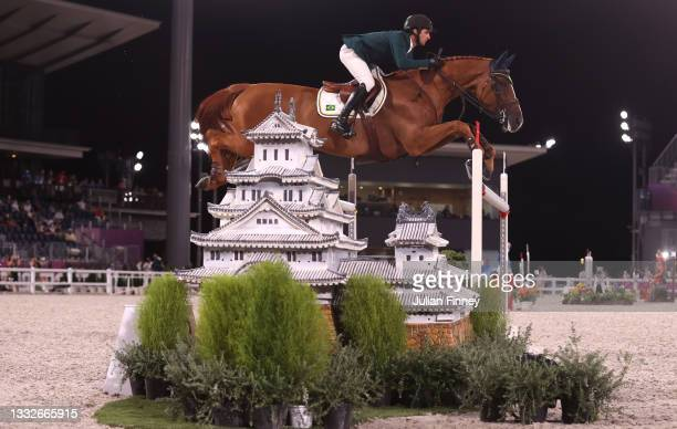 Marlon Modolo Zanotelli of Team Brazil riding Edgar M competes during the Equestrian Jumping Team Qualifier on day fourteen of the Tokyo 2020 Olympic...