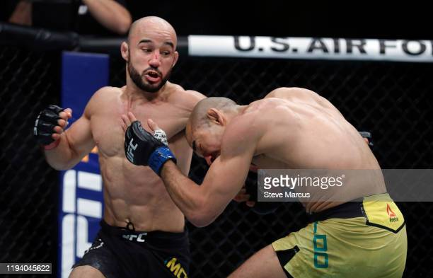 Marlon Moraes battles Jose Aldo in their bantamweight fight during UFC 245 at T-Mobile Arena on December 14, 2019 in Las Vegas, Nevada. Moraes won...
