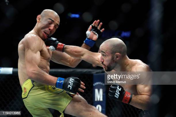 Marlon Moraes connects with a punch on Jose Aldo in their bantamweight fight during UFC 245 at T-Mobile Arena on December 14, 2019 in Las Vegas,...