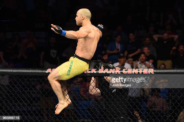 Marlon Moraes of Brazil celebrates after defeating Jimmie Rivera in their bantamweight fight during the UFC Fight Night event at the Adirondack Bank...