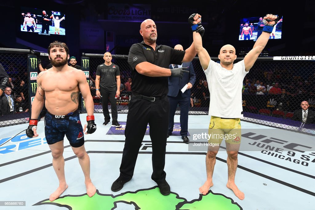 Marlon Moraes of Brazil celebrates after defeating Jimmie Rivera in their bantamweight fight during the UFC Fight Night event at the Adirondack Bank Center on June 1, 2018 in Utica, New York.