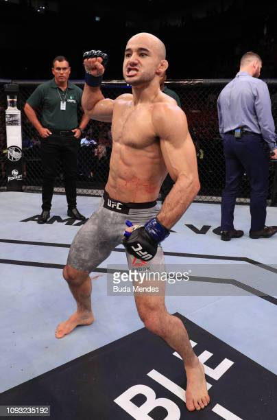 Marlon Moraes of Brazil celebrates after his knockout victory over Raphael Assuncao of Brazil in their bantamweight fight during the UFC Fight Night...